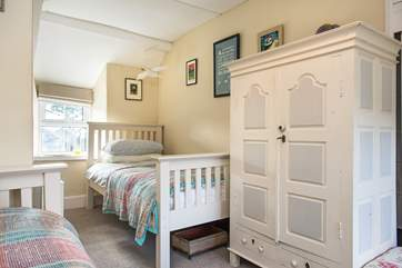 The twin bedroom is light and airy and has plenty of storage