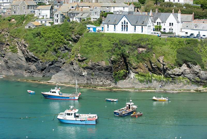 Port Isaac (of Doc Martin fame) is a delightful fishing village with narrow streets, quirky shops, great places to eat and drink and  the occasional live performance by The Fishermans friends