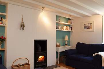 The comfortable sitting-room has a roaring wood-burner.