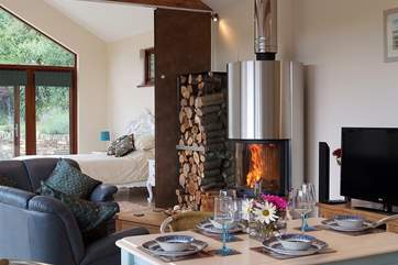 The wood-burner is the focal point of the room.