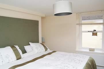 The first floor bedroom (Bedroom 1) has 'zip and link' (double or twin) beds.