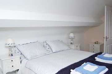 The top floor bedroom has a 5' bed. This is Bedroom 2.