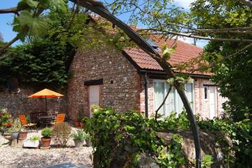A view of Apple Cottage showing its sunny outside seating-area.