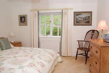 The pretty double bedroom, Bedroom 2, has a really tranquil feel.