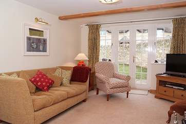 Another view of the spacious sitting-room with its comfortable sofas.