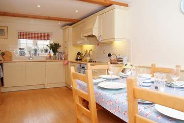 The kitchen/dining-room is a cheerful and welcoming room.