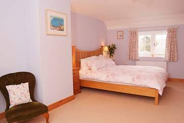 The master bedroom (Bedroom 1) is exceptionally spacious. Dual aspect windows allow the light to flood in.