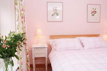 Another view of the double bedroom with its pretty furnishings.