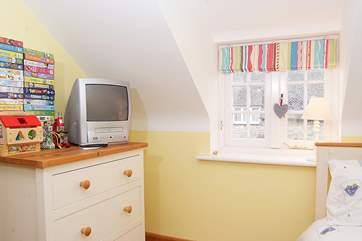 The children's room has a video player and a selection of videos and games.
