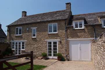 There is an enclosed garden and private parking at the rear of the cottage.