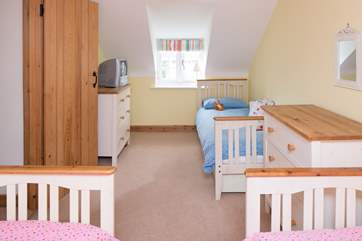 The third bedroom has three single beds (2'6