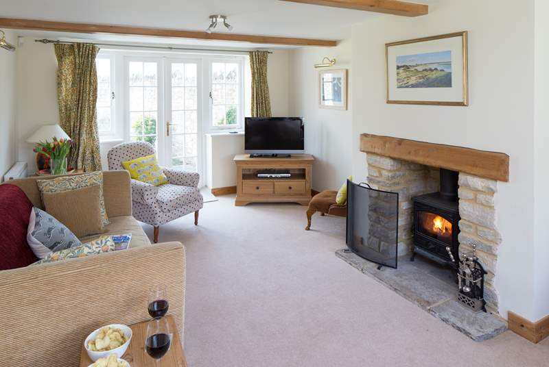 The sitting-room has a wood-burner and French doors to the enclosed rear garden.