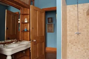 The en suite shower-room to Bedroom 6.