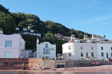Bay Cottage is on the ground floor of the house in the middle of the photograph.