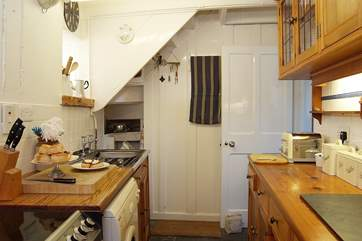 The galley-kitchen is perfectly in-keeping with the cottage.