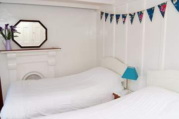 The twin bedroom is very light and has sea views.