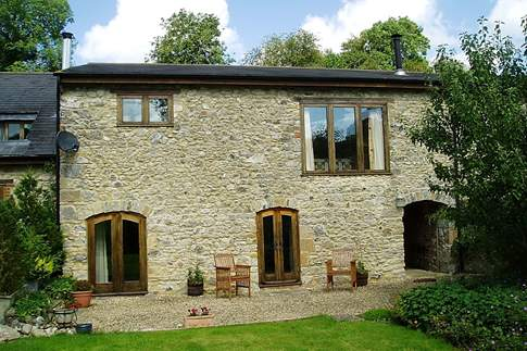 Purtington Barn Cottage is part of a lovely barn conversion (the middle section).