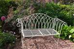 This pretty bench is tucked away in the rear garden.