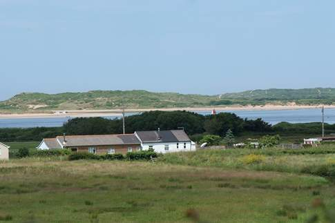 This is the special setting for Sea Cottage, the white cottage in this photograph.