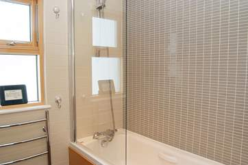 The bathroom and en suite shower-room are bright and modern.