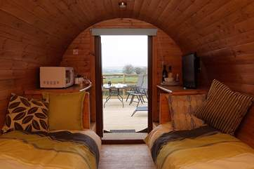 Relax inside the cosy Living Pod and still enjoy the far reaching views.