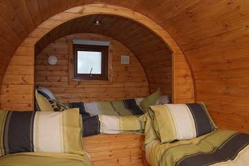 The cosy interior of the Living Pod provides you with a double bed (4' wide) and two singles (2' wide).