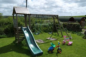 The childrens play area is just beside the pods.