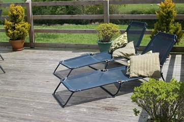 Two sun loungers so that you can relax.
