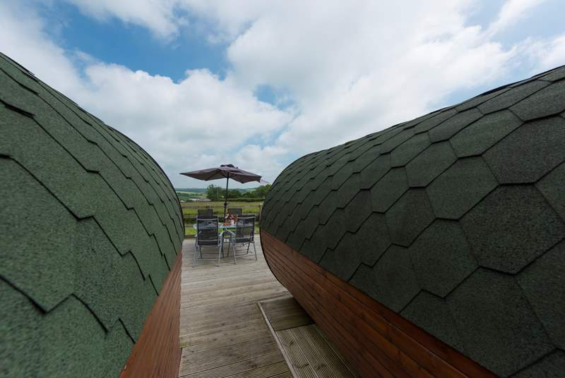 The pods sit on a large deck overlooking open countryside where there is plenty of space to dine, barbecue and sunbathe.