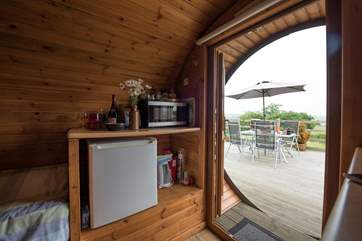 You also have your little kitchen-area within the Living Pod with microwave, fridge, kettle and a flatscreen TV too.