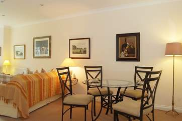 The lovely glass dining-table and wrought iron chairs are an indication of the high quality you will find in this apartment.