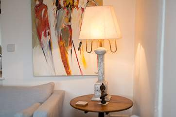Throughout the farmhouse you will find bright and contemporary artwork and stunning outsize lamps to add atmosphere