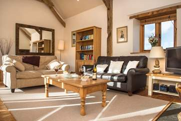 The sitting room has wonderful high ceilings and plenty of room for all