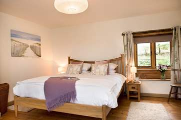 The double aspect  master bedroom is very spacious and beautifully furnished