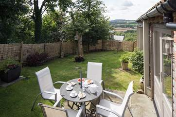 The sheltered garden at the rear of the cottage has fabulous views.