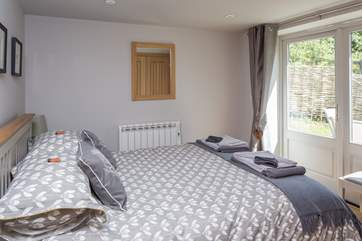 The master bedroom has a 5' bed, plenty of storage in fitted wardrobes and French doors that lead out to the enclosed and secluded rear garden.