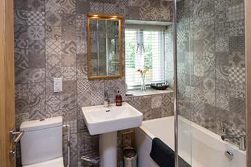 The stylish bathroom has luxurious toiletries perfect from holiday pampering.