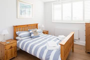 Bedroom 2 has a comfy 4ft 6in bed and plenty of space with built-in wardrobes,