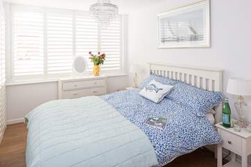 The master bedroom has a super comfy 4ft 6 bed and gorgeous linens. The small en suite and a further door separates this room from the other bedrooms.