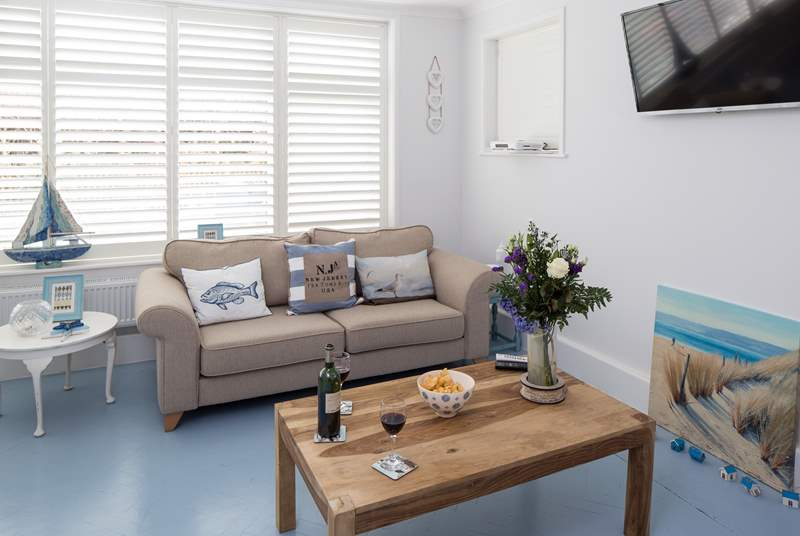 The open plan living-room is filled with light and has stylish plantation shutters. There is a Sonos bluetooth system, so you can have music to relax to or watch the Smart TV or a DVD.