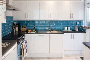 The modern kitchen has a gas hob and double electric oven, all you need to create a decadent holiday meal.