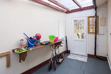The garden-room gives lots of extra space for storing bikes and buckets and spades. It doubles up as a games-room too. It is a great way to come in if you have sandy feet or dogs too.