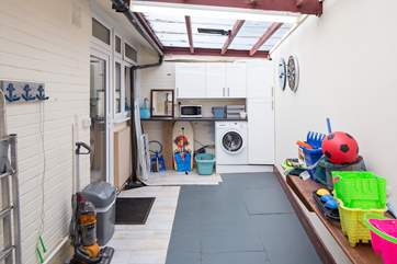 The garden-room is not heated but gives lots of extra storage space and room for children to play.