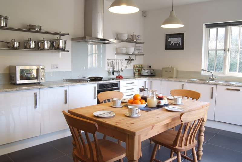 The spacious kitchen/breakfast-room has doors out onto the decking with uninterrupted views down the valley.
