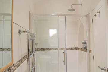 The en suite shower-room with extra large shower cubicle.