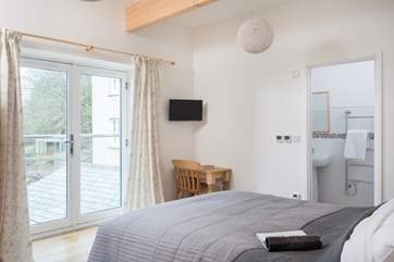 The double bedroom has a juliette balcony with views down to the valley below.