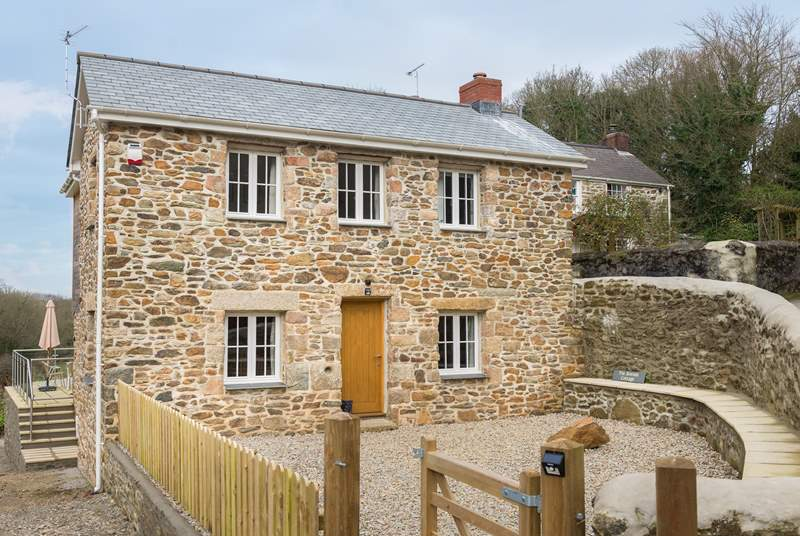 Tin Stream cottage sits alongside the Owners home behind and Shuffley Barn behind that