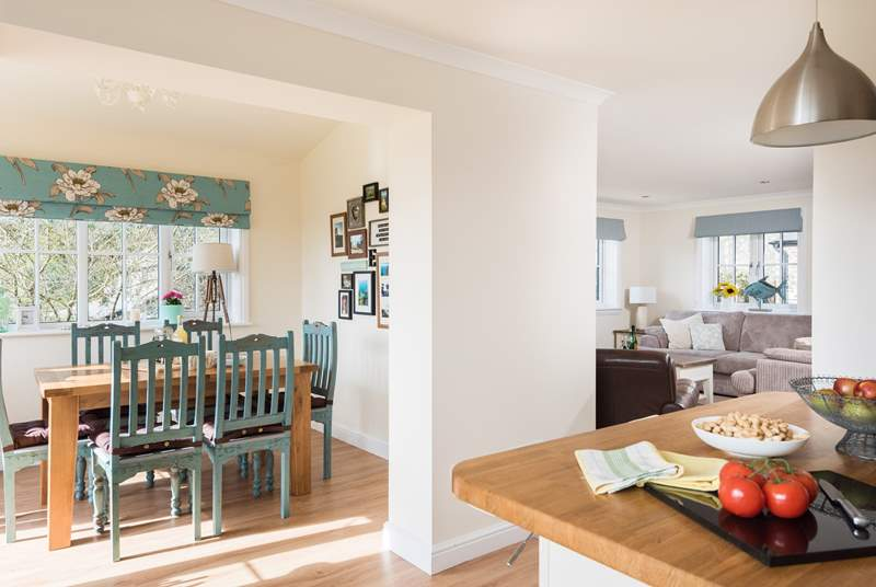 The kitchen sits between the dining-room and sitting-room, all in all a very social space.