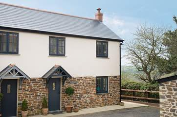 This pretty semi-detached cottage is located at the end of the driveway.