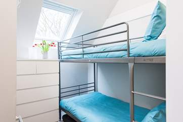 Bedroom 4 is a cosy bunk-room.